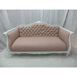 Sofá restaurado en polipiel rosa